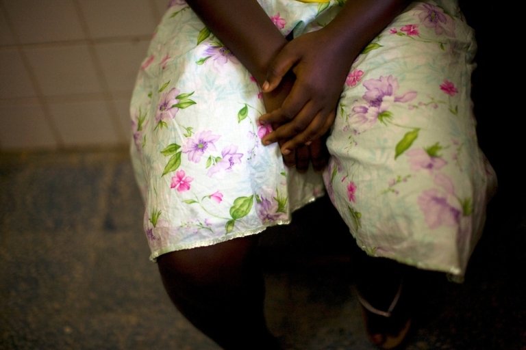 <p>A 15-year-old woman seeking medical treatment waits at the Doctors Without Boarders (MSF) clinic in Monrovia on November 30, 2009, after being raped.</p>