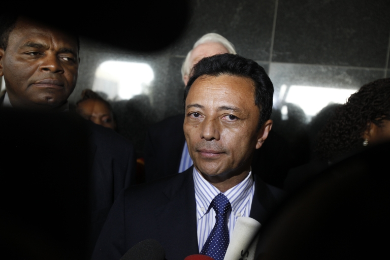 <p>Madagascar's ousted leader Marc Ravalomanana addresses the press on Jan. 21, 2012, as he leaves O.R. Tambo international Airport in Johannesburg, after the island nation barred him from flying home to end his three-year exile.</p>
