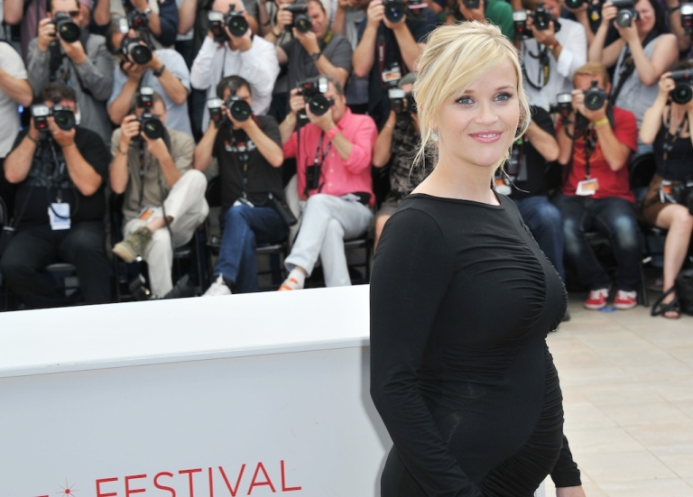 <p>Reese Witherspoon strikes a pose at the Cannes Film Festival in France on May 26, 2012.</p>