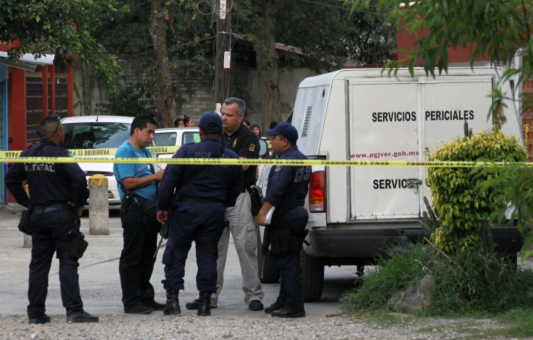 <p>Police gather outside the house of Mexican journalist Regina Martinez, in Xalapa, Veracruz State, Mexico, on April 28, 2012.</p>