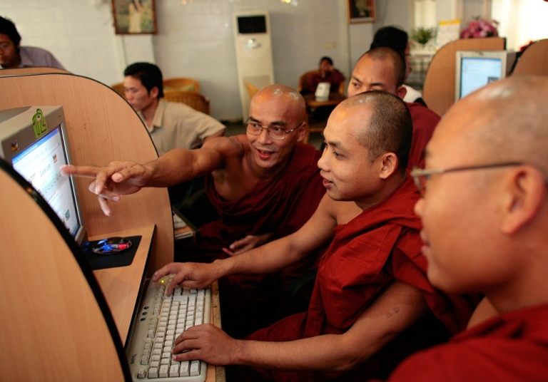 <p>Burmese monks work on computers scanning Buddhist websites at a local internet cafe February 22, 2007 in Mandalay, Myanmar (Burma). The internet is strictly controlled by the government banning all free email services such as yahoo, hotmail and aol. With economic sanctions crippling the Burmese economy its people are eager for change and a better life. According to government experts who are working on a seven step road map to democracy, within the next few months the Draft Constitution will be finalized which will hopefully bring a Referendum for Constitution by the end of the year. After that a Democratic election will be held in 2008. According to the current scenario the change may happen soon but many say that Burmese will be afraid to vote with their heart but will cast their vote to prevent trouble.</p>