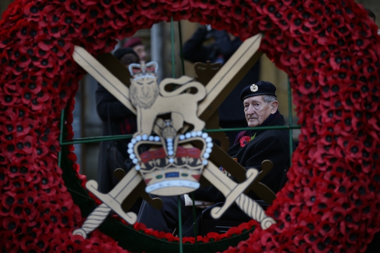 <p>A veteran looks at a large poppy wreath at the Royal British Legion Field of Remembrance at Westminster Abbey on November 8, 2012 in London, England. Hundreds of small crosses bearing a poppy have been planted in a Field of Remembrance in a tribute to British servicemen and women who have lost their lives in conflict.</p>
