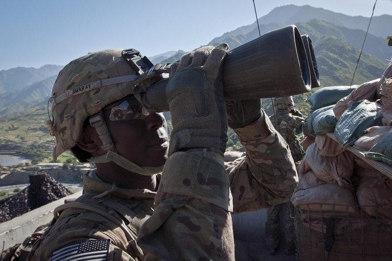 <p>U.S. Army Pfc. William A. Swaray, an infantryman and native of Monrovia, Liberia, assigned to Company B, 2nd Battalion, 27th Infantry Regiment, Task Force No Fear, 3rd Brigade Combat Team, 25th Infantry Division, TF Bronco, scans for insurgent activity at Observation Post Coleman outside of Combat Outpost Monti in eastern Afghanistan's Kunar Province, on May 5, 2011.</p>