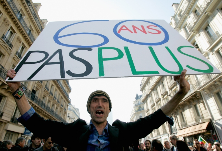 <p>A man holds a placard reading '60 years old no more' on October 12, 2010 in Paris, France. French staged a national day of strikes over the government's pension reforms.</p>