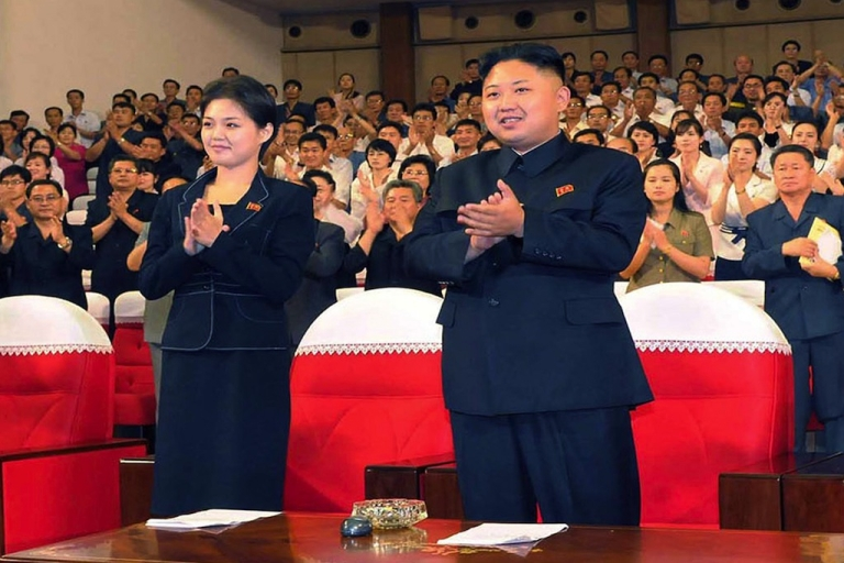 <p>Kim Jong Un stands with his wife, Ri Sol Ju.</p>