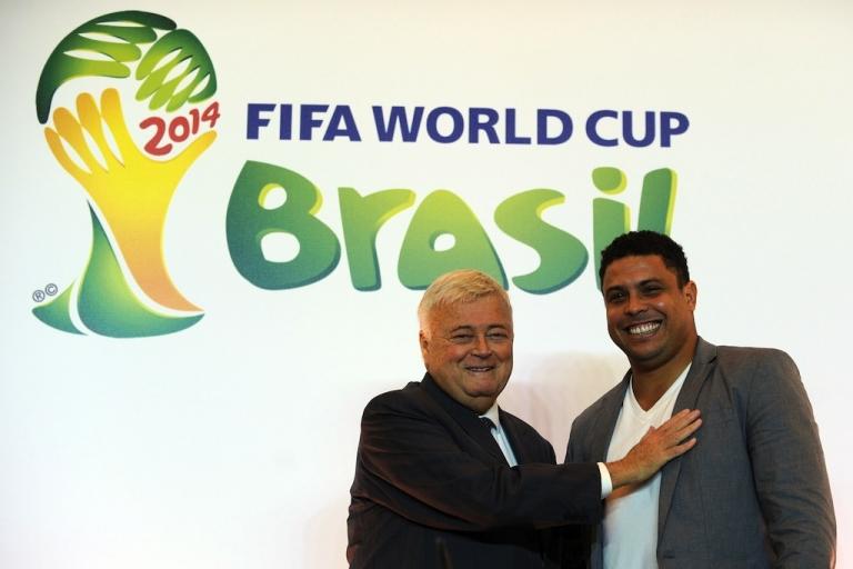 <p>Ricardo Teixeira (L), poses for a picture with Ronaldo Nazario during a press conference to announce Ronaldo as member of the Brazil 2014 FIFA World Cup Council, on December 1, 2011, in Rio de Janeiro, Brazil.</p>