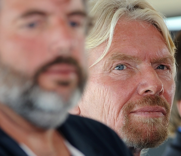 <p>Sir Richard Branson and explorer Chris Welsh (L) attend a press conference in Newport Beach, California on April 5, 2011 to announce plans to take a solo piloted submarine to the deepest points in each of the world's five oceans.</p>
