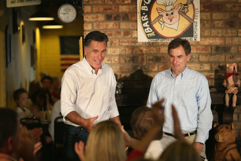 <p>Republican presidential candidate Mitt Romney and US Senate Candidate Richard Mourdock (R-IN) (R) greet supporters at a campaign event at Stepto's Bar B Q Shack on August 4, 2012 in Evansville, Indiana.</p>