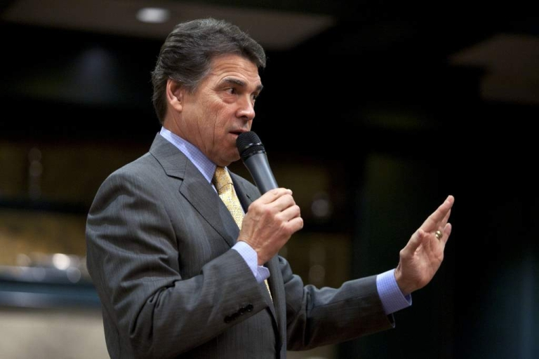 <p>HAMPTON, NH -  OCTOBER 1:  Republican presidential candidate and Texas Governor Rick Perry speaks to local residents at the ??We the People: A First in the Nation Freedom Forum?? town hall event on October 1, 2011, in Hampton, NH.</p>