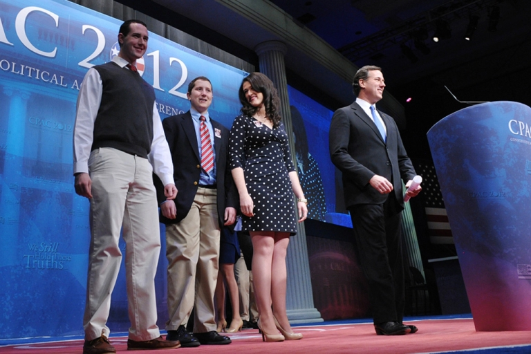 <p>Presidential candidate Rick Santorum arrives on stage with his family to address the 39th Conservative Political Action Committee today in Washington.</p>