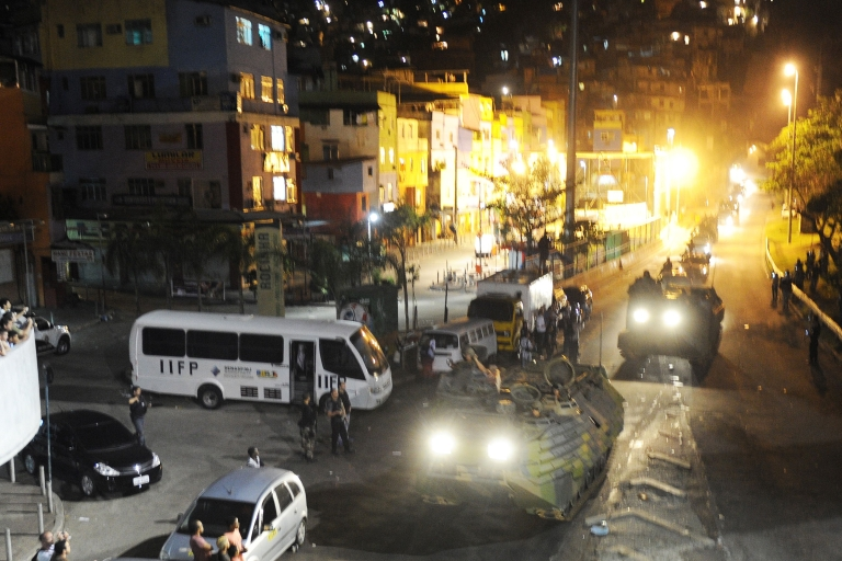 <p>Brazilian Navy assault vehicles arrive at Rocinha shantytown early on November 13, 2011. Police forces launched a major operation to wrest from criminals control of the Rocinha favela, in Rio de Janeiro.</p>