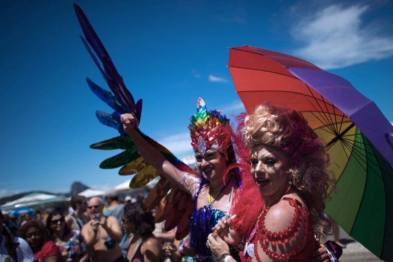 <p>Two transvestites pose during the gay pride parade at Copacabana beach in Rio de Janeiro, Brazil on November 18, 2012.</p>