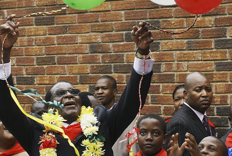 <p>Zimbabwean President Robert Mugabe frolics with balloons on his birthday in 2010. Mugabe, who's been in power since 1980, will turn 89 on Feb. 21, 2013.</p>