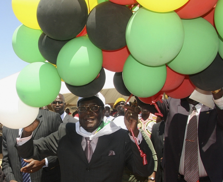 <p>Mugabe with balloons in the colors of his political party, ZANU-PF, at 84th birthday celebrations in Beitbridge. Mugabe appears unconcerned with the prospect of world helium shortages.</p>