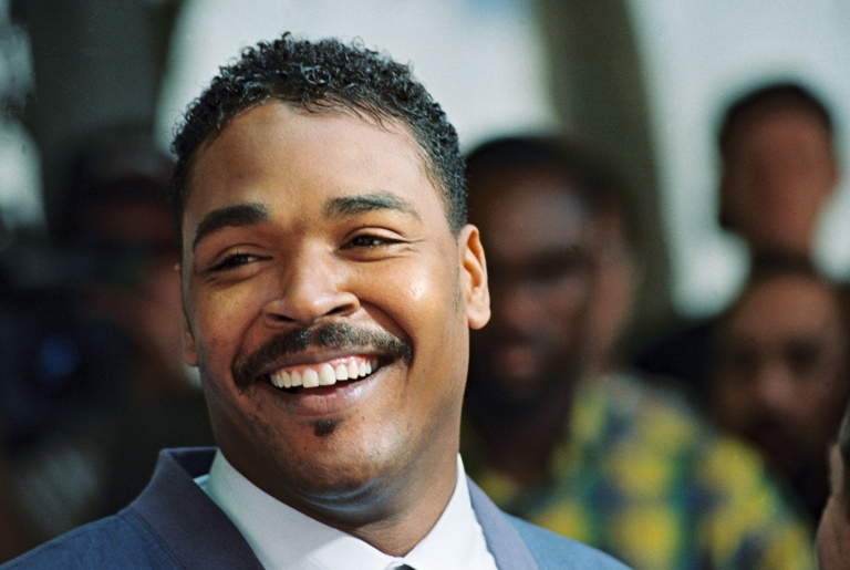 <p>Rodney King at a press conference in Beverly Hills on May 1, 1992, where he called for an end to violence in the city.</p>