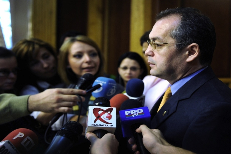 <p>Emil Boc (R) addresses the media shortly after Romanian President Traian Basescu presented him as the new designated Prime Minister at the Romanian Parliament Palace in Bucharest, on Dec. 15, 2008.</p>