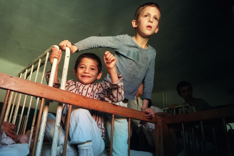 <p>Abandoned Romanian children get ready for bed in 1990. Experts say institutionalization past the age of 2 causes irreversible effects.</p>