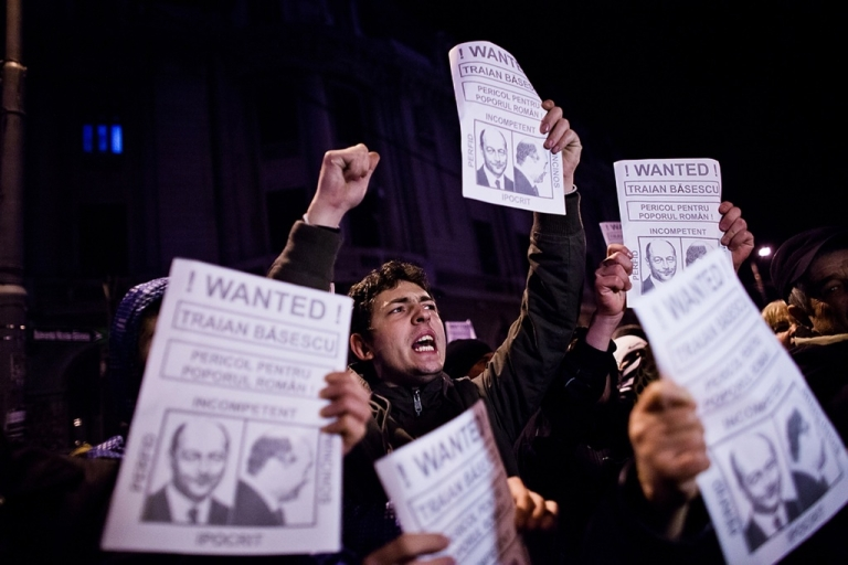 <p>Protesters opposed to austerity measures imposed by the government demonstrate on January 14, 2012 in Bucharest, Romania. Romania has slashed public wages and raised taxes in attempts to cut its budget deficit and meet pledges to both the International Monetary Fund and the European Union.</p>