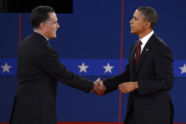 <p>US President Barack Obama and Republican presidential candidate Mitt Romney shake hands following the second presidential debate at the David Mack Center at Hofstra University in Hempstead, New York, October 16, 2012.</p>