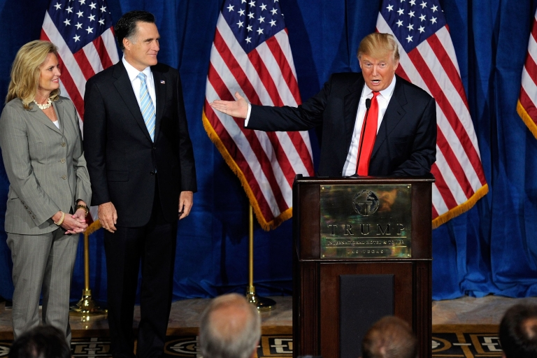 """<p>Speaking at a packed news conference yesterday in his Las Vegas hotel, and flanked by Romney and his wife, Ann, Trump (R) said: """"Mitt is tough, he's sharp, he's smart.  He's not going to allow bad things to continue to happen to this country that we all love.""""</p>"""