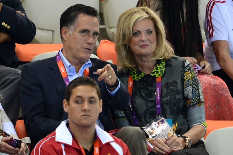<p>US presidential hopeful Mitt Romney talks to his wife Ann as they attend the men's 400-meter individual medley swimming event at the 2012 London Olympics on July 28, 2012 in London.</p>