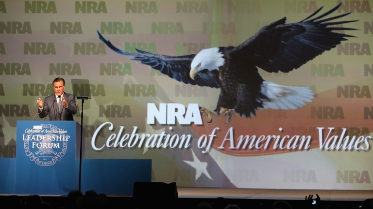 <p>Mitt Romney speaks at the 138th National Rifle Association of America meetings on May 15, 2009 in Phoenix, Arizona. Romney's position on gun control has evolved substantially over time.</p>