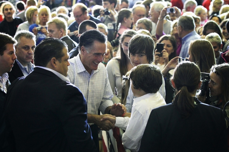 <p>Republican US presidential candidate Mitt Romney (L) greets supporters during a campaign rally at Westerville South High School Sept. 26, 2012 in Westerville, Ohio. Romney continued his two-day 'Romney Plan For A Stronger Middle Class' bus tour in the state of Ohio.</p>