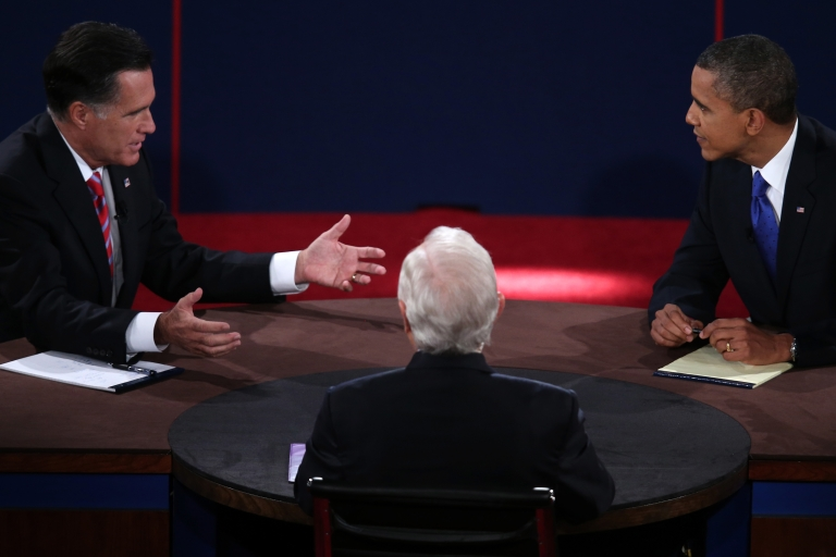 <p>US President Barack Obama debates with Republican presidential candidate Mitt Romney as moderator Bob Schieffer listens at the Keith C. and Elaine Johnson Wold Performing Arts Center at Lynn University on Oct. 22, 2012 in Boca Raton, Fla.</p>
