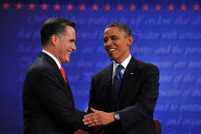 <p>US President Barack Obama and Republican challenger Mitt Romney shake hands following their first debate at the University of Denver in Denver, Colorado, Oct. 3.</p>