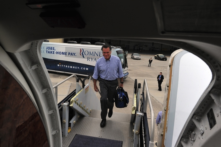 <p>US Republican presidential candidate Mitt Romney boards his campaign plane on October 7, 2012 in Palm Beach, Florida.</p>