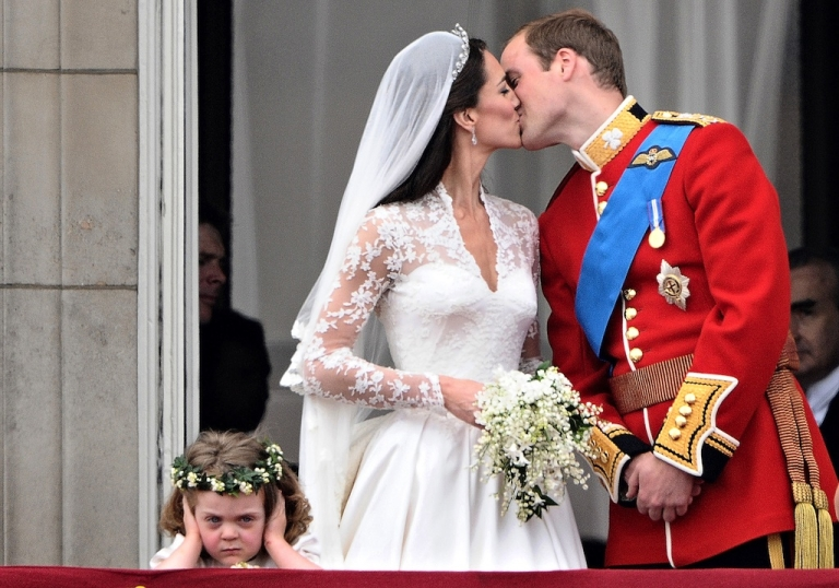 <p>Britain's Prince William kisses his wife Kate, Duchess of Cambridge, on the balcony of Buckingham Palace, after their wedding service, on April 29, 2011, in London.</p>