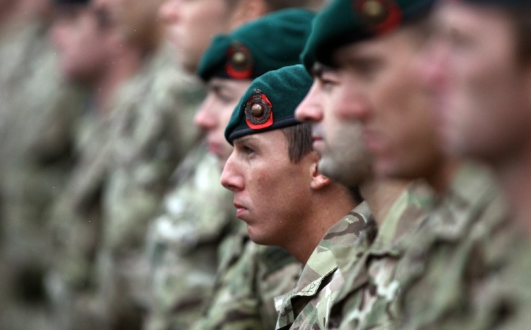 <p>Royal Marines line up for a parade at Plymouth Hoe on November 11, 2011 in Plymouth, England.</p>