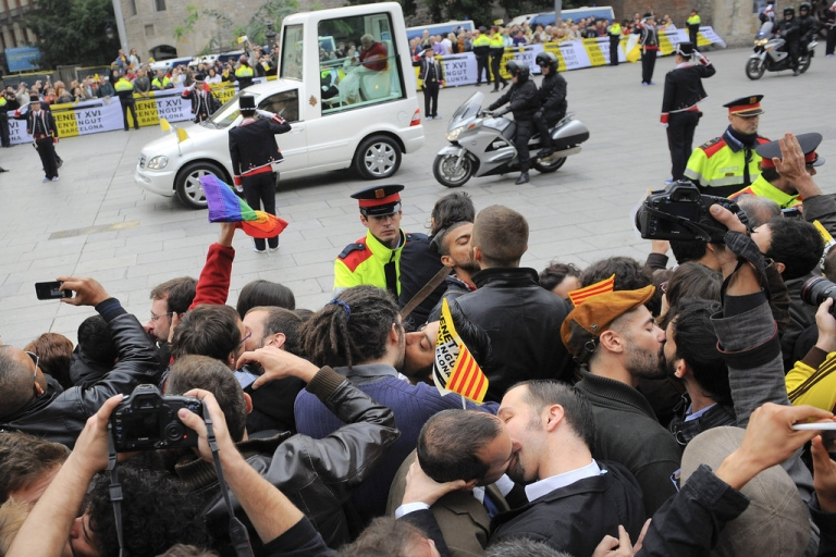 <p>Gay couples kiss in protest as Pope Benedit XVI travels to La Sagrada Familia Basilica on November 7, 2010 in Barcelona, Spain.</p>