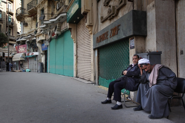 <p>Local men sit next to closed shops on Jan. 31, 2011 in Cairo, Egypt. Most shops remain closed after more than two weeks of protests against the rule of President Hosni Mubarak.</p>
