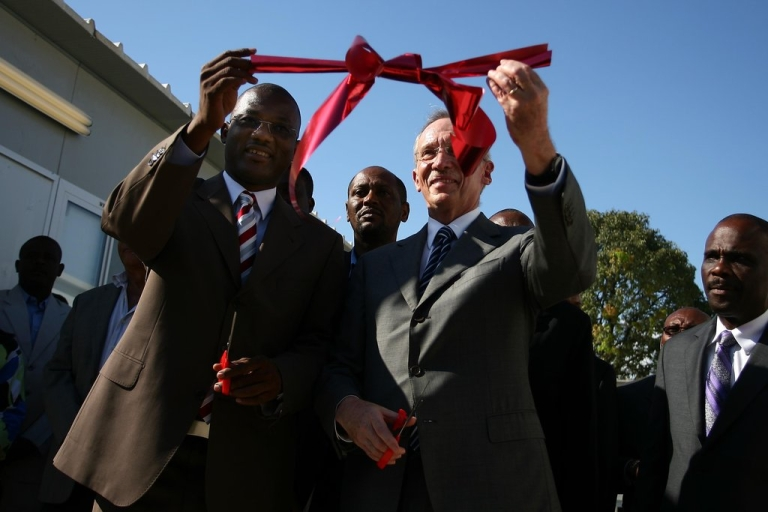 <p>Edmond Mulet (R), head of the United Nations mission in Haiti, and Haitian Sen. Kely C. Bastien (L), inaugurate the facilities of the interim parliament in Port-au-Prince on April 20, 2011. The UN built the structure to serve until the USAID-funded building is complete.</p>