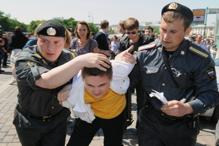 <p>Russian police detain a gay rights activist during an attempt to hold an unauthorized rally in central Moscow on May 28, 2010. Moscow police detained three prominent global gay rights leaders as violence broke out.</p>