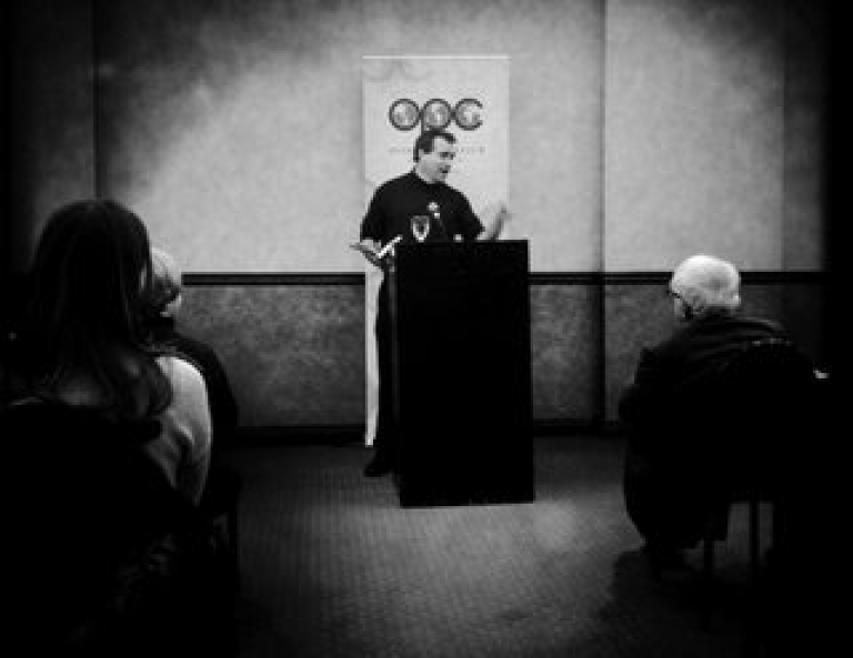 <p>GlobalPost executive editor and co-founder Charles Sennott reads from