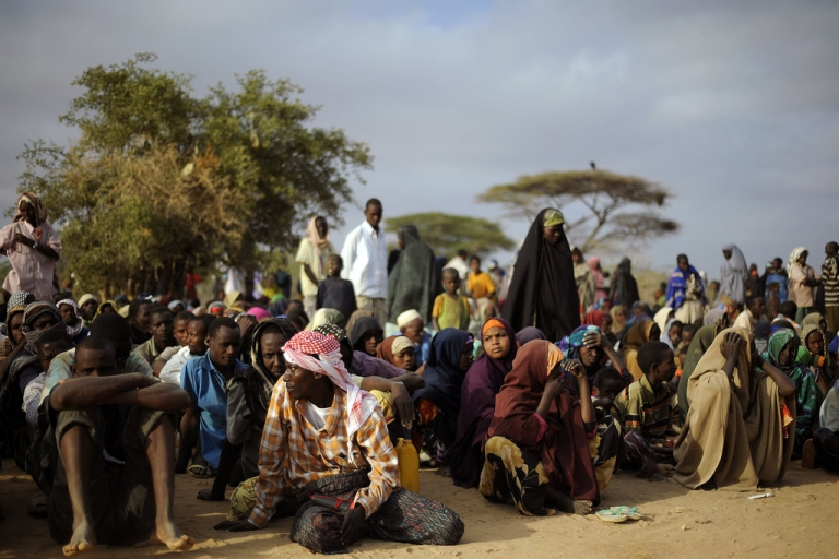 <p>Somali refugees line up at a registration center in one of northern Kenya's refugee camps to receive aid after having been displaced from their homes by a famine that is ravaging the horn of Africa region. Ugandans like Alex and Michael make up a small fraction of the hundreds of thousands of refugees in the camps.</p>
