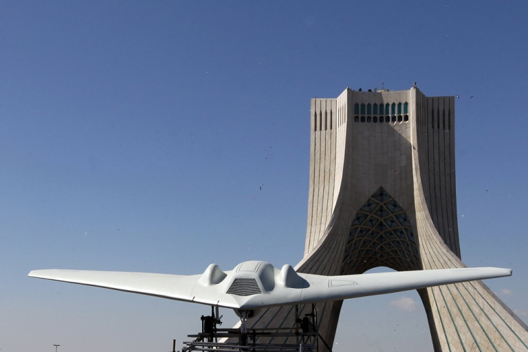 <p>A captured US RQ-170 drone is on display next to the Azadi (Freedom) tower during the 33rd anniversary of the Islamic revolution in Tehran on February 11, 2012. Iranian President Mahmoud Ahmadinejad said that Iran has broken the 'idol' of the Holocaust underpinning the creation of the Israeli state and US hegemony.</p>
