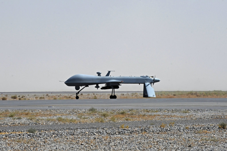 <p>A US Predator unmanned drone armed with a missile stands on the tarmac of Kandahar military airport in 2010. Drones have been a key element of the fight against al-Qaeda in Afghanistan, Pakistan and elsewhere.</p>