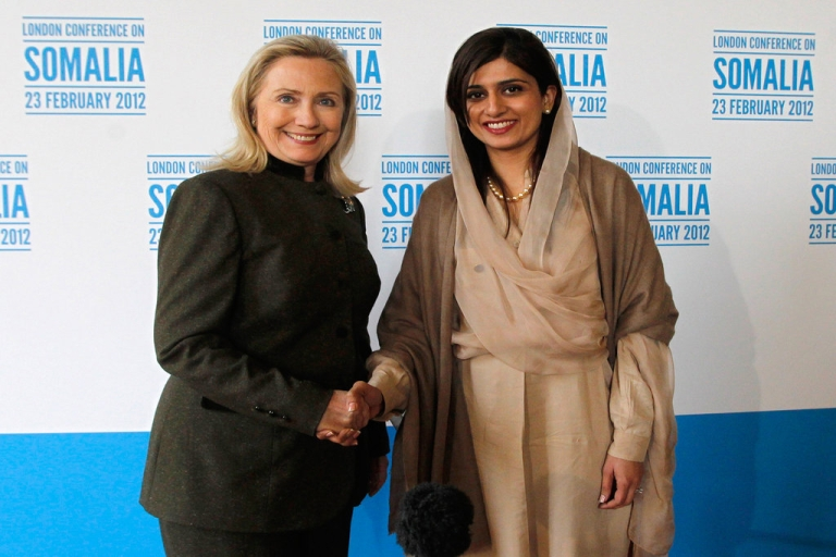 <p>US Secretary of State Hillary Clinton (L) poses for pictures with Pakistan's Foreign Minister Hina Rabbani Khar during the Conference on Somalia at Lancaster House in London on February 23, 2012.</p>