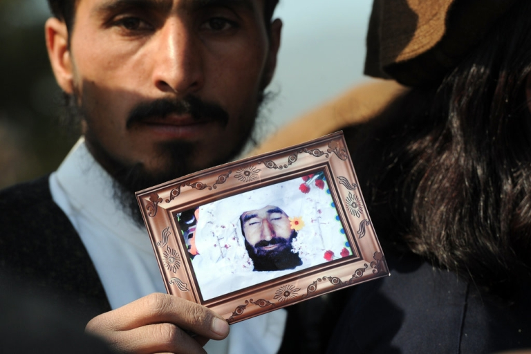 <p>A Pakistani tribesman shows a photograph of a US drone attack victim during a protest in Islamabad on February 25, 2012, against the US drone attacks in the Pakistani tribal region. The protesters demanded an immediate end to drone attacks and compensation for those who lost relatives or property.</p>