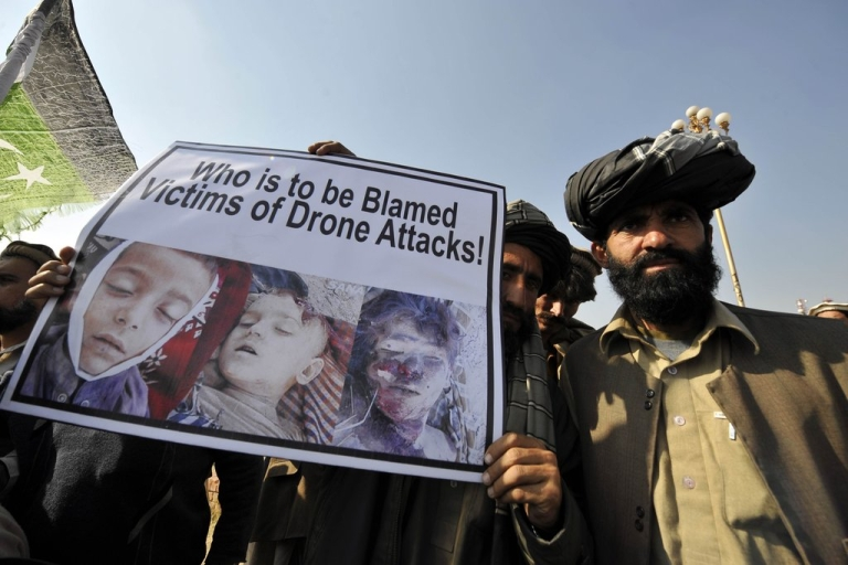 <p>Pakistani tribesmen hold up a placard of alleged drone strike victims during a protest in Islamabad on February 25, 2012 against the US drone attacks in the country's tribal region. The protesters demanded an immediate end to drone attacks and compensation for those who lost relatives or property.</p>