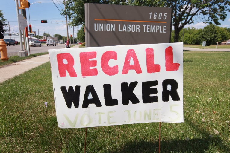 <p>A 'recall Walker' sign sits in the front lawn of the AFL-CIO Union Hall June 4, 2012 in Janesville, Wisconsin. Democrat Milwaukee Mayor Tom Barrett tried to unseat Republican Wisconsin Governor Scott Walker in a recall election Tuesday. Opponents of Walker forced the election after the governor pushed to change the collective bargaining process for public employees in the state.</p>