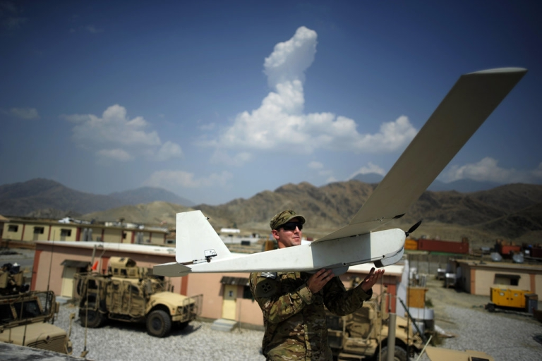 <p>Liutenant David McCurdy of the Baker Comapny 2-12 infantry of the US Army prepares to launch a Puma Dorin airplane at the Forward Operating Base Joyce in the Kunar province on August 20, 2012. NATO has some 130,000 troops in Afghanistan who are due to pull out in 2014 and are spending increasing amounts of time working alongside and training Afghan forces who will take over when they leave.</p>