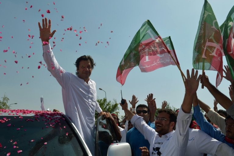 <p>Pakistan cricketer turned politician Imran Khan waves to supporters at the start of a rally on the outskirts of Islamabad on October 6, 2012. Khan is leading western peace activists and local loyalists on a highly publicised rally to Pakistan's tribal belt in protest against US drone strikes.</p>