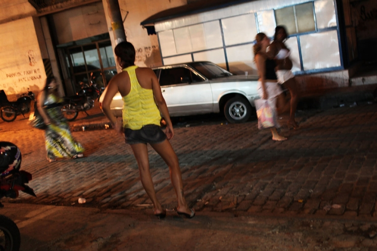<p>Female prostitutes walk the streets of the red light district, Vila Mimosa, following a fashion show with clothes designed by sex workers on December 11, 2009 in Rio de Janeiro, Brazil.</p>