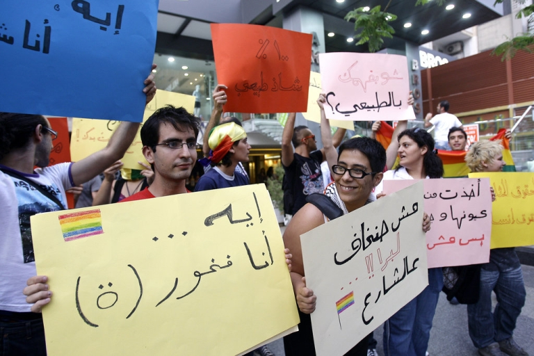 <p>Lebanese protesters hold signs in support of homosexual people and against their discrimination during a demonstration on the eve of the International Day Against Homophobia in Beirut on May 16, 2010</p>