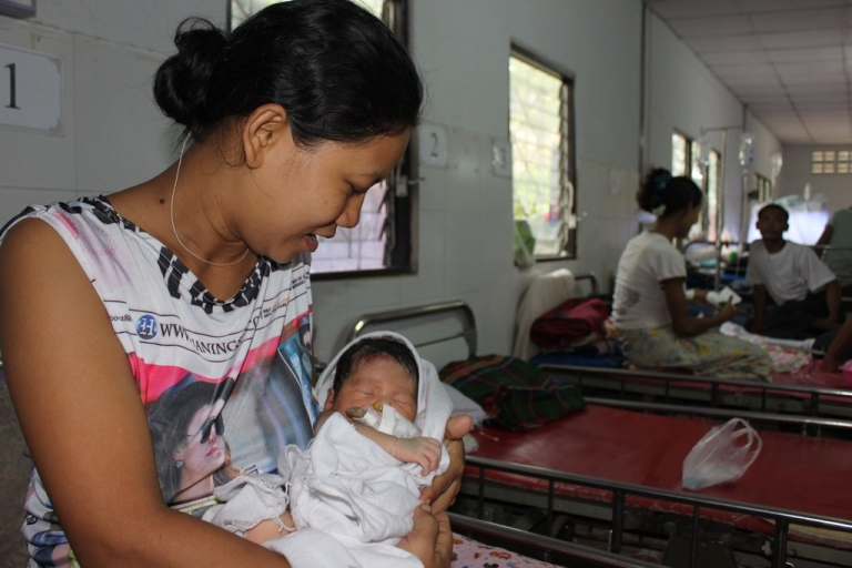 <p>Aye Aye Thu, 30, from Myawaddy Division in Myanmar pictured at the Mae Tao Clinic in Mae Sot, Thailand with her newborn girl. Like many women unable to find quality, affordable health care in Myanmar, she crossed the border into Thailand to give birth.</p>
