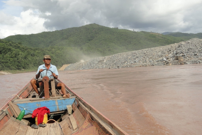 <p>A boatman on the Mekong River, which is already experiencing major effects from dams built in China. The Xayaburi Dam on the Laotian part of the river could have devastating consequences for those who make their livings along the Mekong.</p>